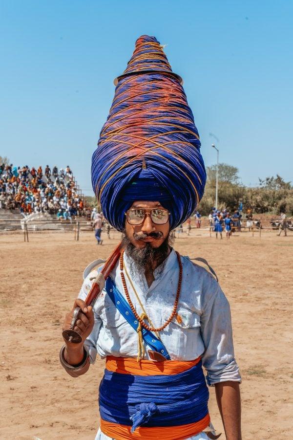 Punjabi voice actors - man holds sword in Punjab India