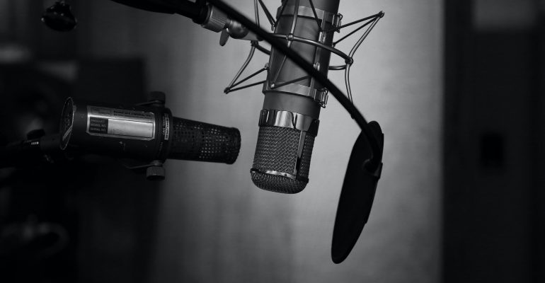 Things to Do When Seeking a Professional Voice Over - Two studio microphones