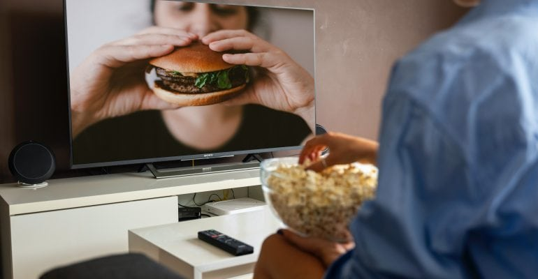 How Long Should TV Commercial Be - Man watches burger ad