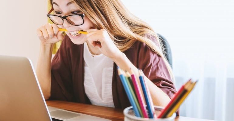 How to Improve Learning Retention Using Voiceover - female student chewing pencil