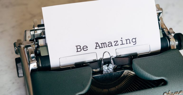 How to Write Killer Commercial Scripts - typewriter with sheet that says Be Amazing
