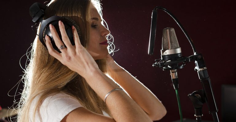 Dubbing-A Comprehensive Guide - Female voice talent with mic