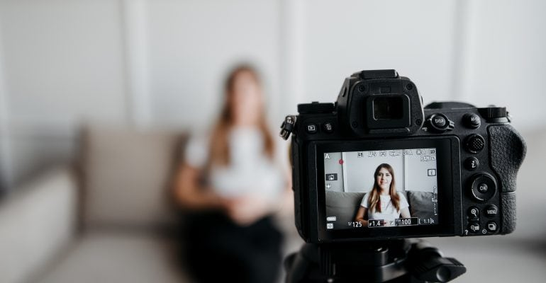 Explainer Videos Why Hire a Pro Voice Actor - Young woman sits in front of camera