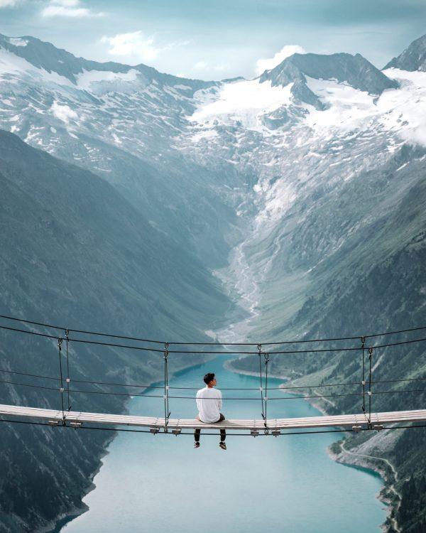 Austrian German voice actors - man on bridge viewing the Alps