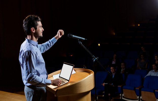 Characteristics of voice over —man giving a speech