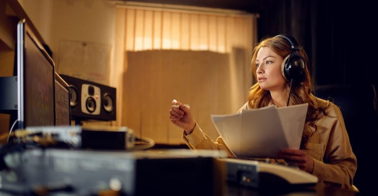 6 Tips for Directing Voiceover Talent - Female audio producer in recording studio